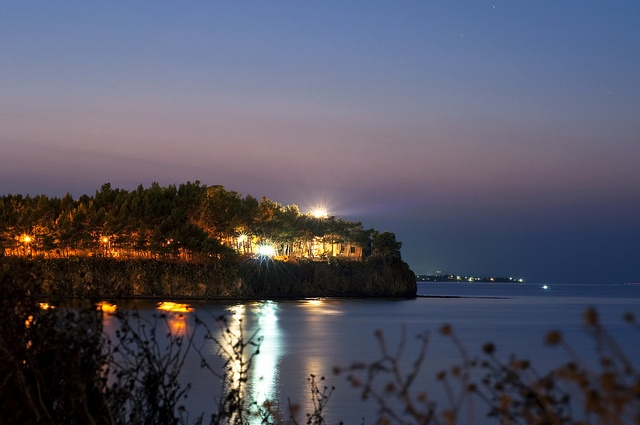 miss my home away from home...  the lighthouse of Chalkis at night by feleris, via Flickr