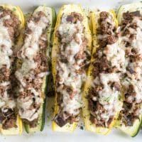 These easy stuffed summer squash boats are made with yellow squash & zucchini. They're packedwith gooey Swiss cheese, ground beef &shiitake mushrooms.