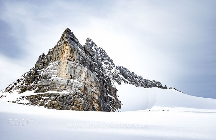 "Let's Get Small - Backcountry skiers on their way up to tjhe peak of Dachstein glacier in Austria.  Image available for licensing.  Order prints of my images online, shipping worldwide via  <a href=""http://www.pixopolitan.net/photographers/oberschneider-christoph-a6030.html"">Pixopolitan</a> See more of my work here:  <a href=""http://www.oberschneider.com"">www.oberschneider.com</a>  Facebook: <a href=""http://www.facebook.com/Christoph.Oberschneider.Photography"">Christoph Oberschneider…"