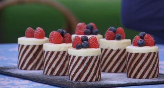 Mary Berry shows how to make double chocolate entremets on The Great British Bake Off 2014 Masterclass. The entremets are topped with fruit on a layer of white chocolate mousse and filled with dark chocolate wrapped in a almond sponge. Related Posts