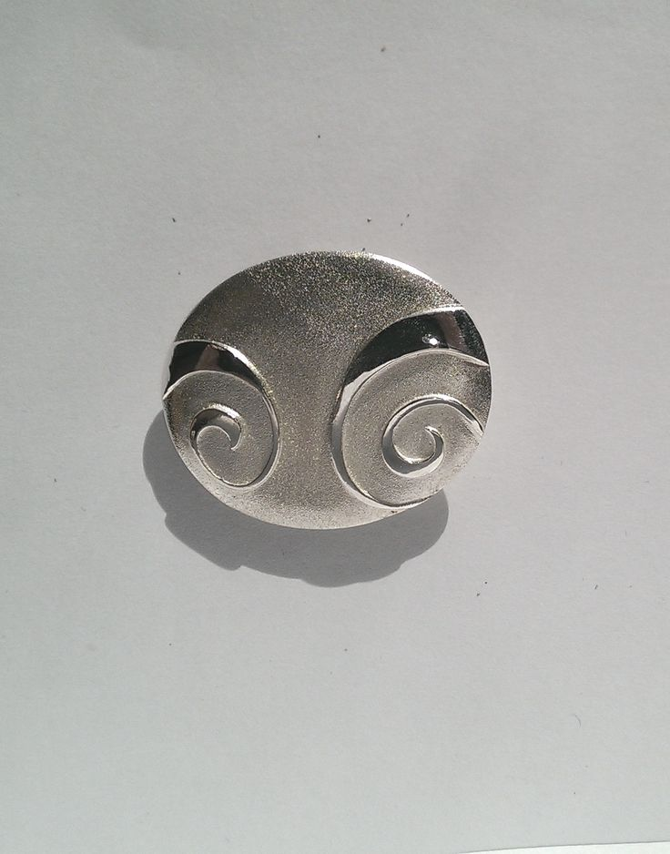 Spiral Pebble brooch... part of a collection inspired by carved spiral decoration.