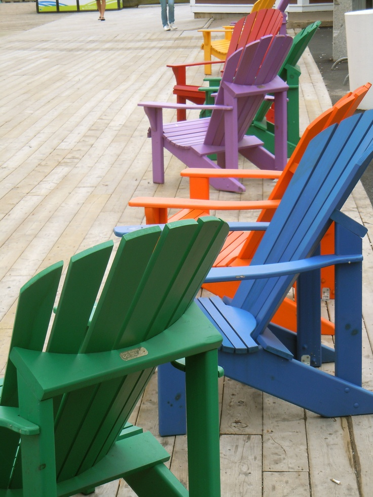 Colourful adirondack chairs on the Halifax waterfront.  You will see them everywhere in Nova Scotia !