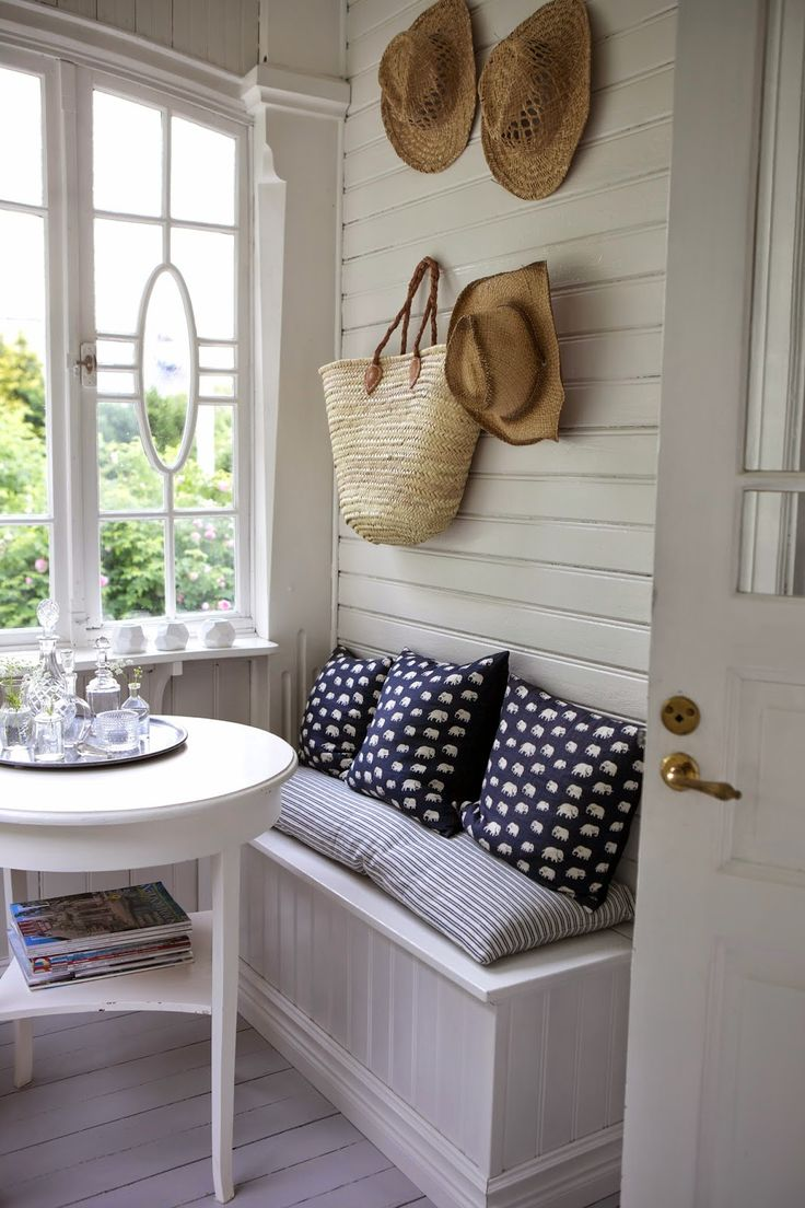 A microcosm of perfect summer house style - wood panelling, built-in seating, pretty window, painted furniture with sparkling accessories - and straw hats. Lillavillavita blog