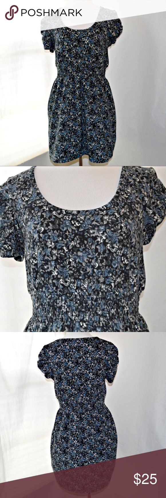 "Manguun Black and Blue Floral Dress Black and blue floral printed dress by Manguun. Made of a sweater-like material. Has an elastic waistband. In excellent condition!  | Measurements |  Size: Medium  Length: 31"" Bust: 33""  