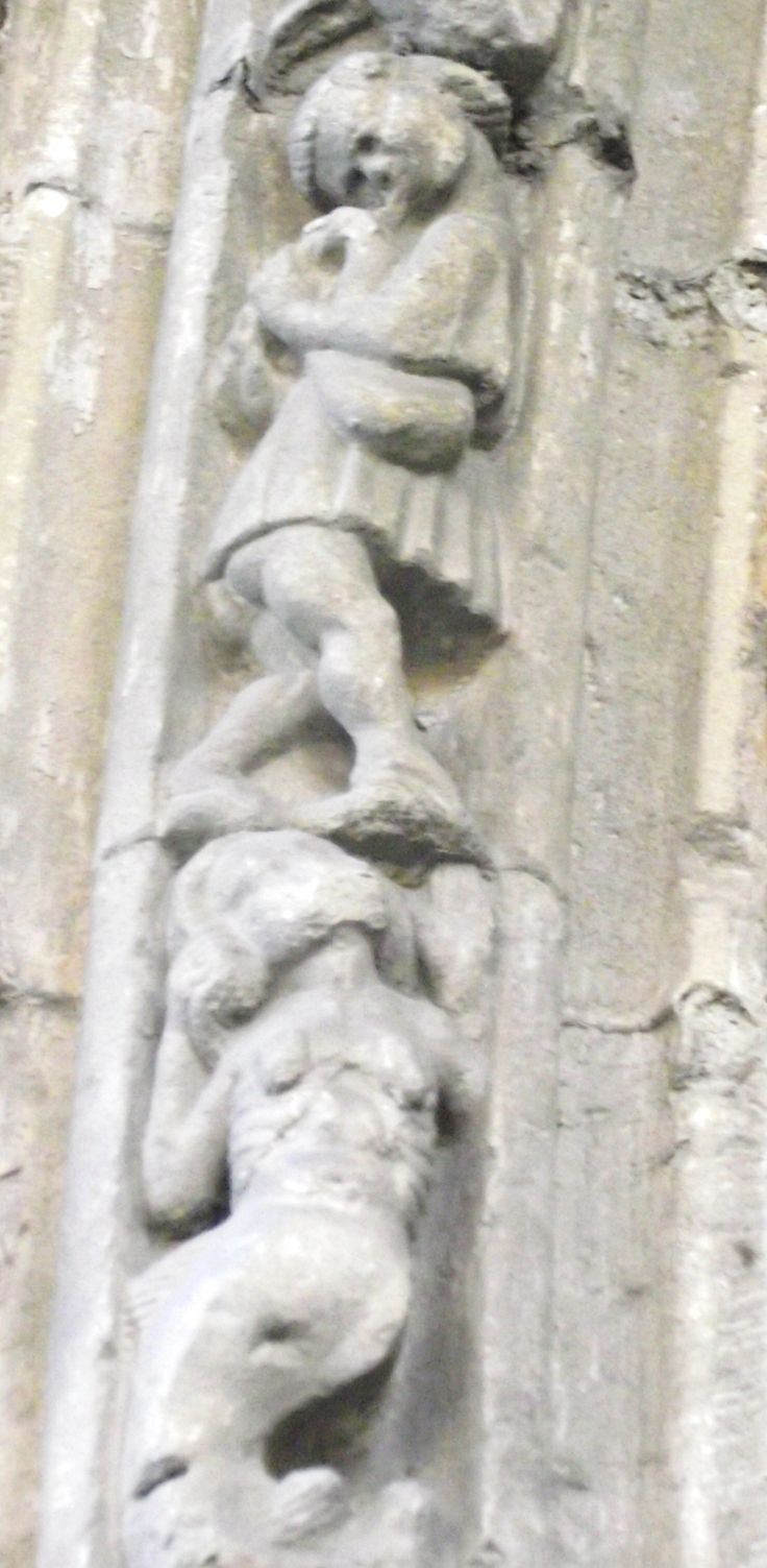Bishop Booth's porch of 1518 at Hereford Cathedral contains rows of sculpted figures, often amusing and risqué. This innocent mermaid throws her hands up in horror at the sight above her. Bagpipe players were often figures of bawdy in the middle ages. One can almost hear the raspberry he's blowing..