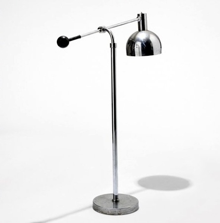 This is an International Style lamp because of the shiny steel.