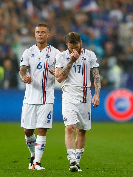 #EURO2016 Dejected Aron Gunnarsson and Ragnar Sigurdsson of Iceland are seen after the UEFA EURO 2016 quarter final match between France and Iceland at Stade...