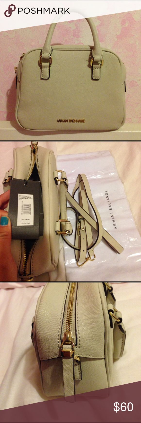 Armani Exchange Mini Saffiano Leather Satchel This purse is in good condition. The leather looks a bit cracked near the opening though on one of the sides and I still kept the tags after all these years. It comes with a dust bag and straps. (From a drug free home) A/X Armani Exchange Bags Satchels