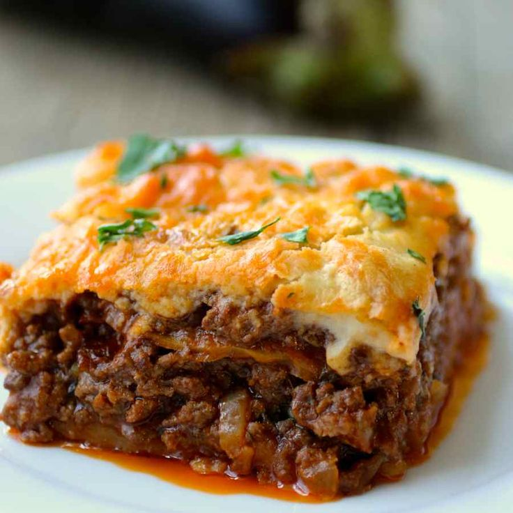 Moussaka is the iconic hearty Greek dish composed of layers of eggplants, saucy ground meat and topped with Béchamel sauce.