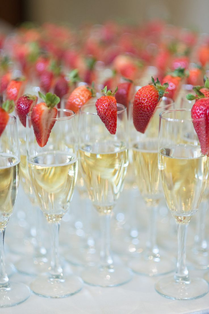 Classic Champagne Flutes + Strawberries for a pop of color   SBP Photography   See the wedding on SMP: http://www.StyleMePretty.com/canada-weddings/2014/03/07/elegant-neutrals-niagara-wedding/