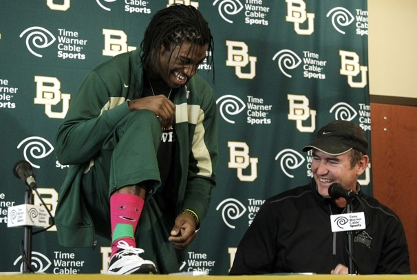 Jan. 11, 2012  Baylor Coach Art Briles, right, laughs as Heisman Trophy winner Robert Griffin III shows off his Barney character socks during a news conference where Griffin announced that he will skip his senior season to enter the NFL draft.  Tony Gutierrez / Associated Press