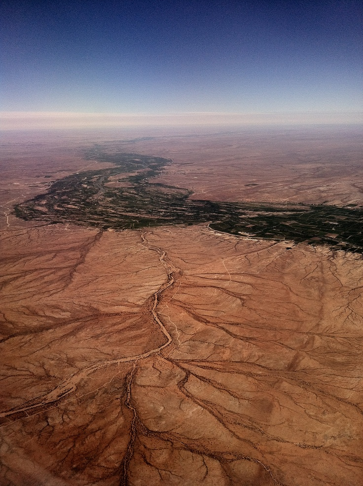 the orange river winding through the red sands of the Kalahari desert, northern cape, south africa