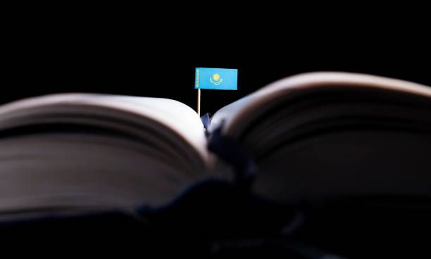 kazakhstan flag in the middle of the book knowledge and education