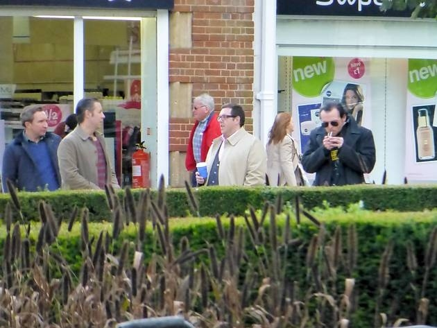 Simon Pegg lights up alongside Nick Frost during filming of The World's End in Welwyn Garden City town centre