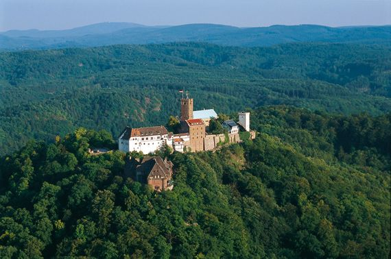 At Wartburg Castle in Eisenach, Martin Luther translated the New Testament of the Bible into German, creating the basis for standard written German.