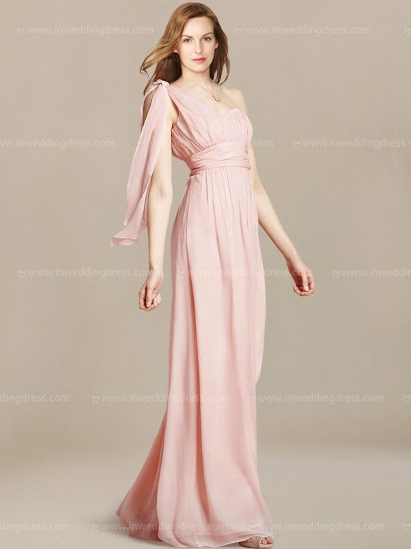 Beach wedding guest dress is a perfect style that provides the comfort to enjoy the special celebration. One-shoulder neckline has a detachable cascading tied at the shoulder. Empire waist is accented by a ruched sash. Completing the look of this gown is a floor length skirt. Side zipper closure. Available in 60 colors, shown in Pink.