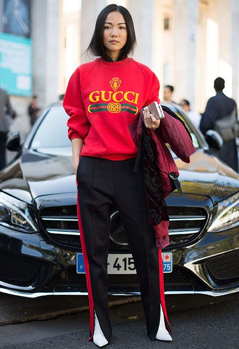If you were worried about how to make a track-style trouser look luxe, consider this your deep breathing exercise. Influencer Yoyo Cao added premium status to her relaxed look with a tucked in 'do and pointed white boots (it's the little things, you know?)