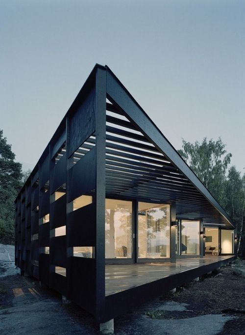 12 Modern House with Black Exteriors: Another shot of Archipelago House by Tham & Videgård Arkitekter. The zigzag design creates outdoor areas that are protected from the wind.