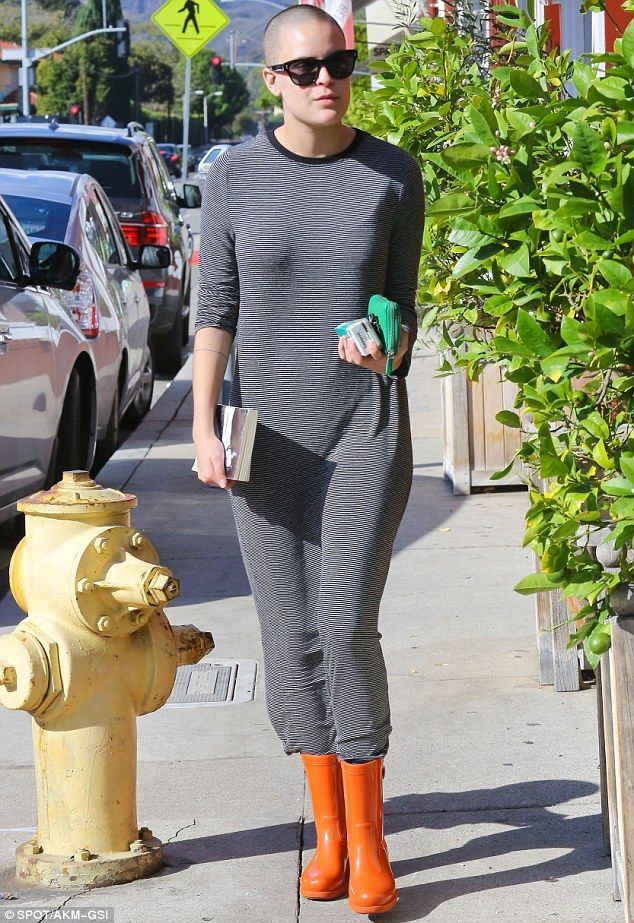 Interesting fashion choice: Tallulah Willis couldn't resist wearing her orange wellies even though there wasn't a puddle left in the Brentwood neighbourhood of Los Angeles on Thursday after the big storm the day before