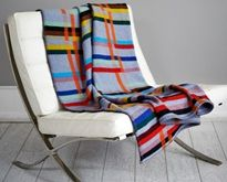 LTM commissioned Wallace Sewell to design and produce a modern lamb's wool fabric featuring the 11 colours of London's Underground lines crossed by the striking orange house colour of London Overground as a tribute to the end of the 150th anniversary of London Underground and to reference a bright, integrated and design led future for the world's oldest Underground network.