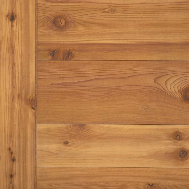 Western Red Cedar Paneling.  Random horizontal plank pattern, with vertical plank along one edge,