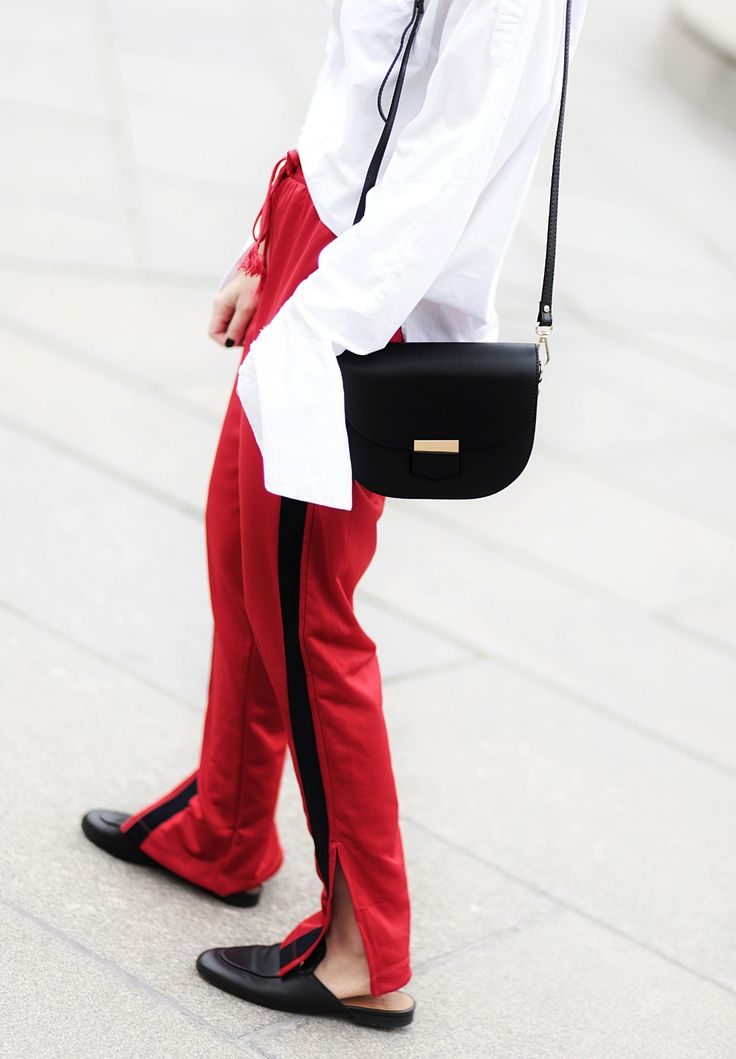 HOW TO WEAR RED TRACK PANTS THE CASUAL CHIC WAY: Gucci Princetown Slipper / Statement Earrings / Oversized sleeves blouse.