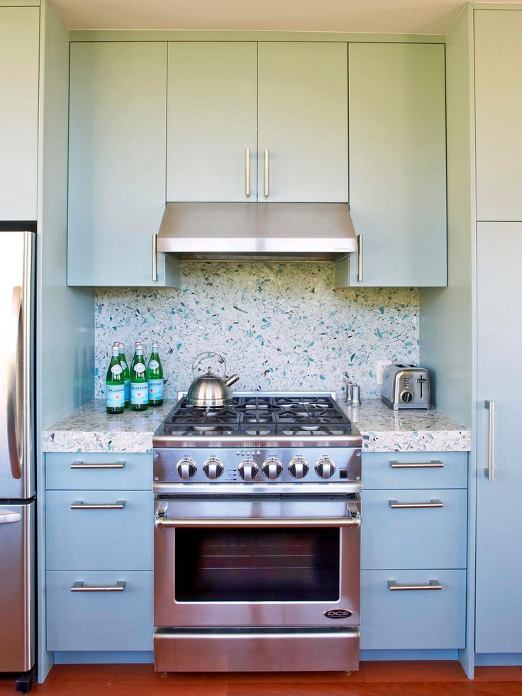 As Durable As It Is Eco Friendly The Seaglass Hued Backsplash And Countertop
