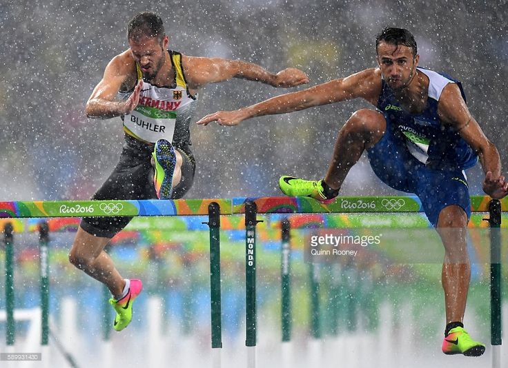 Matthias Buhler of Germany and Milan Trajkovic of Cyprus compete in the rain…