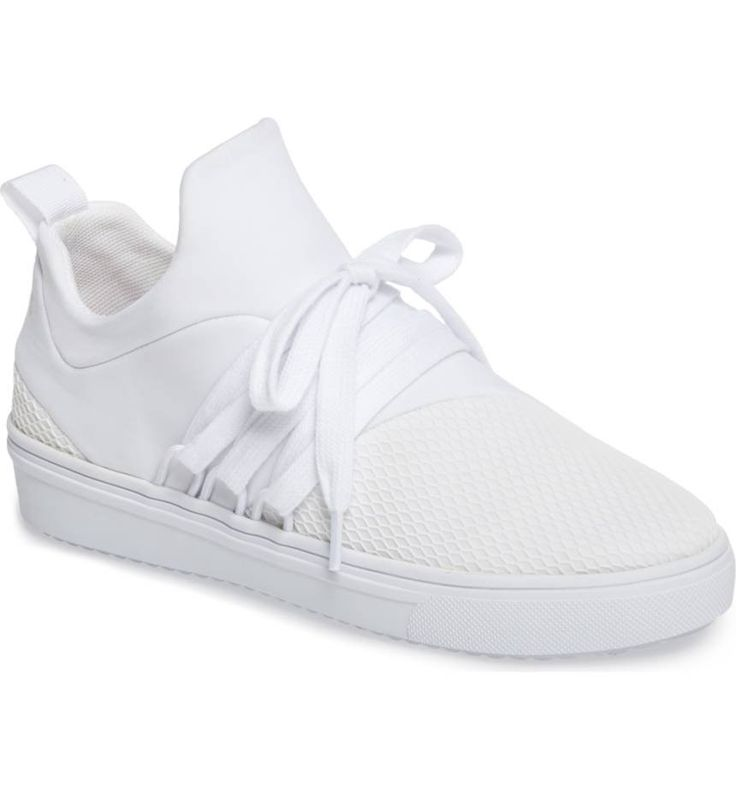 Wide-set laces and a monochromatic palette amplify the modern appeal of a mid-top sneaker perfect for adding athleisure-inspired style to your casual look.