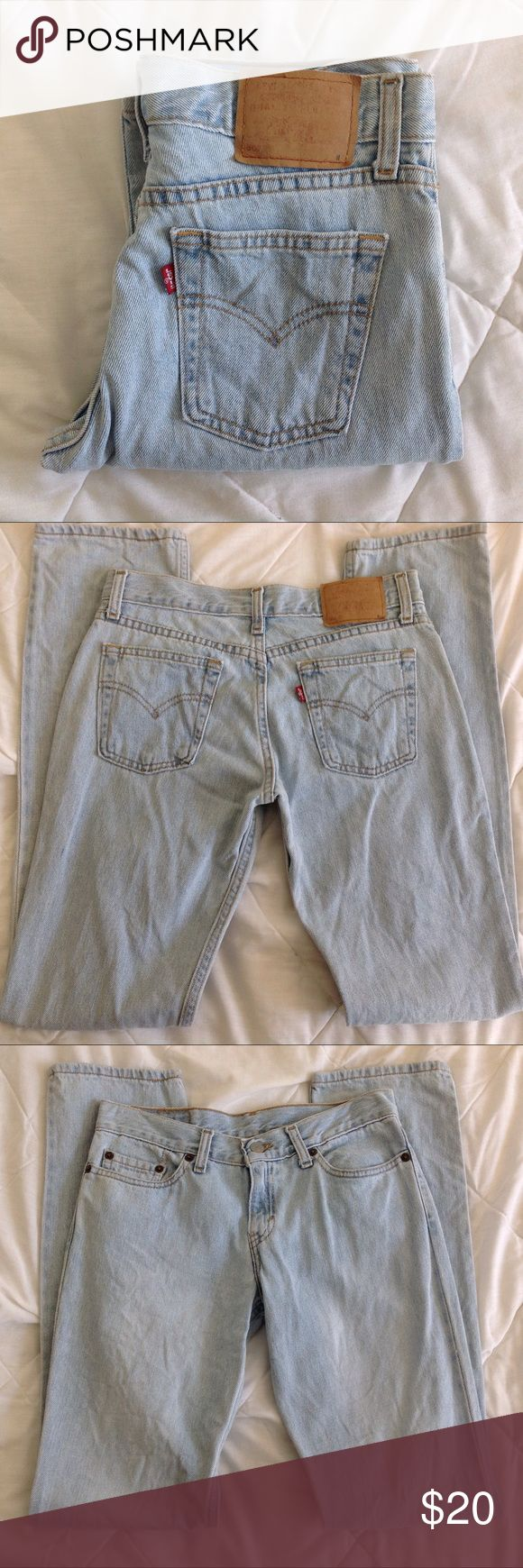 """1990s LEVIS 507 straight leg jeans I believe these are from the 90s.  Heavy 100% cotton light wash straight leg jeans.  There is a tiny hole near the seam on the left thigh, otherwise in good condition.  Tag says 3 jr M.  I measure them at approx 28"""" at the waist, 8.5"""" rise, 18"""" at the hip, inseam 31"""" and ankles about 13.5"""" around.  Color may look different on your screen. Vintage Jeans Straight Leg"""