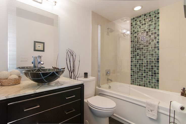 The colours of this bachelor's en-suite were inspired by the argyle patterned vessel sink.