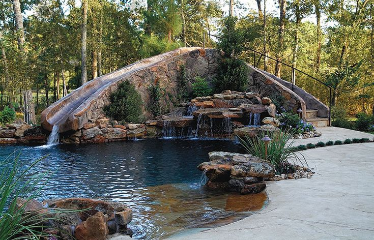 Freeform Pool With Beach Entry Waterfall And Giant