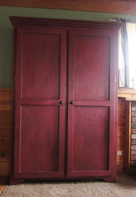 Ana White does it again!....Make it yourself with these plans: http://ana-white.com/2010/03/plans-not-just-the-doors-how-about-the-whole-armoire-the-favorite-bookcase-with-doors.html