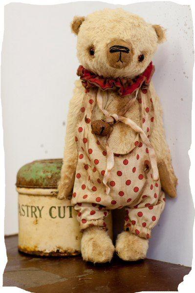 The bear looks so loved/sad.