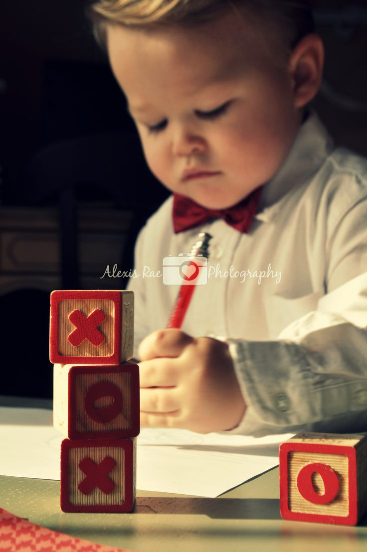 Valentines day photo shoot ideas - valentine photography for kids - Wood blocks and a red bow tie for a Valentines shoot. Photo by: Alexis Rae Photography