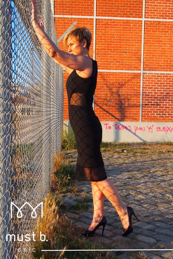 Fashionable black dress with fishnet see-through details SS2015