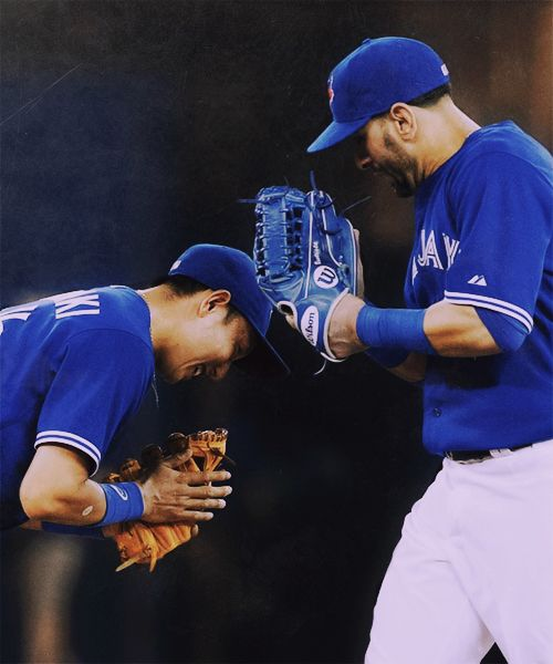Munenori Kawasaki bows to Jose Bautista as the Toronto Blue Jays celebrate their 4-2 win over the Baltimore Orioles, extending their winning streak to 10 games.