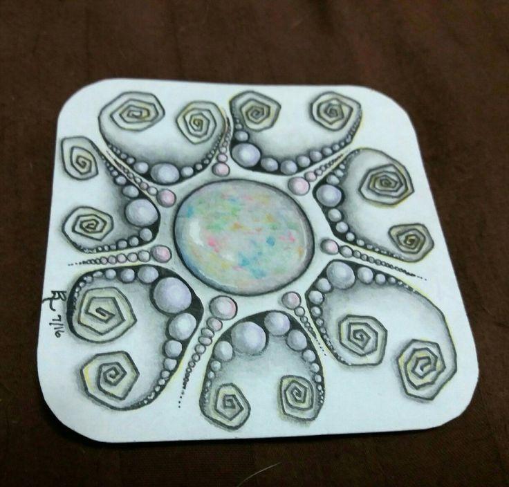 Zentangle with an opal gem centerpiece. By LuAnn Roosa 7/16. Zentangle, ZIA, zendala, gemdala, microns, colored pencil, art, artwork, drawing, gem, opal.