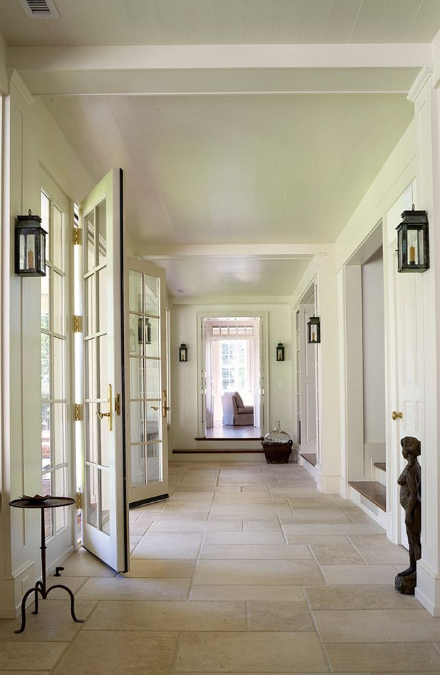 Beautiful entry in cool neutrals. Love the lantern sconces : 3north