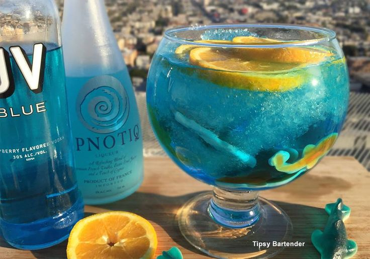 Great White Shark Week Cocktail - For more delicious recipes and drinks, visit us here: www.tipsybartender.com