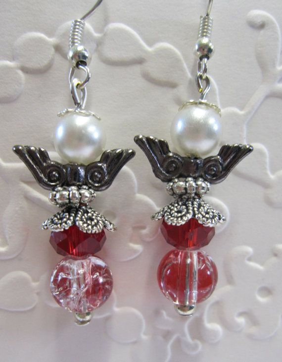 Angel earrings with red and pearl beads.