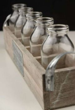 French vintage inspired wood crate with glass bottles. For rectangular table centerpieces.