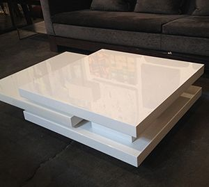 White Lacquer Coffee Table  Can be positioned 3 ways! In excellent condition.  Dimensions: 47 x 31.5 x 12″h at position 1, 63 x 31.5 x 12″ at position 2, 63 x 63 x 12″h at position 3  Retail: $1200  Modern Resale: $650