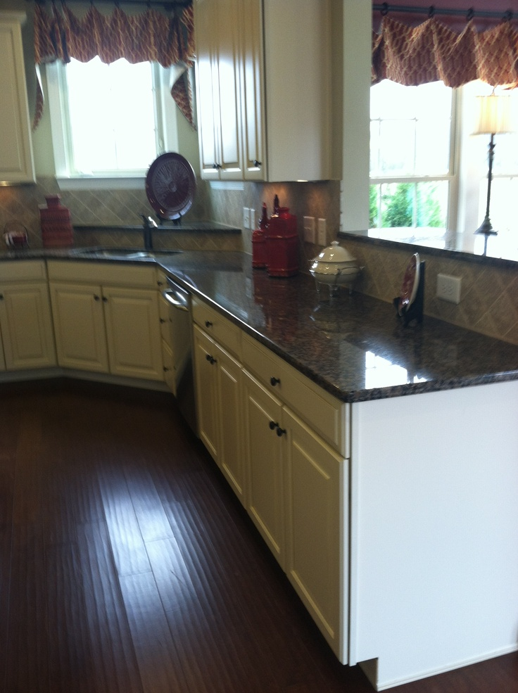 Baltic Brown granite, butterscotch glaze cabinets, dark