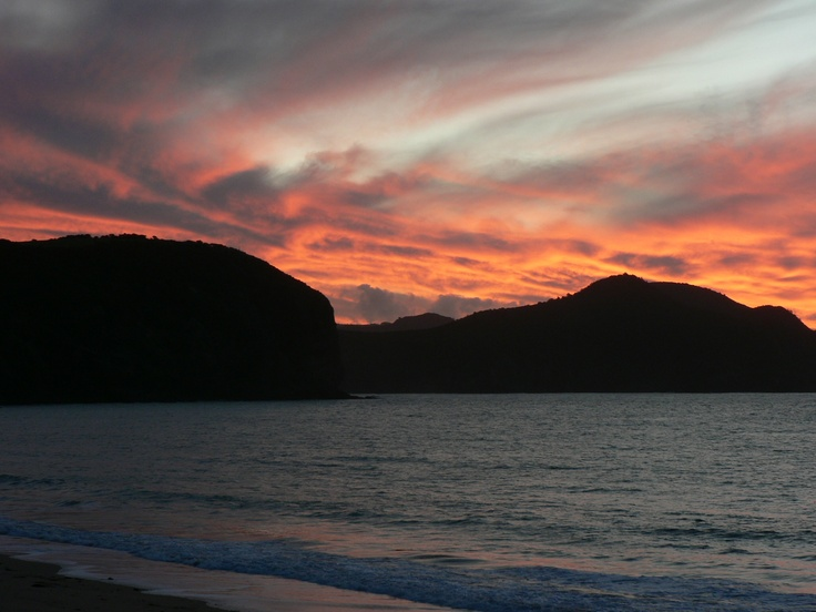 Sunset Tauranga Bay looking over to Whangaroa Harbour mouth Northland NZ