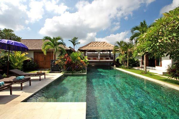 """built in #wooden architecture inspired by antique #Joglo the island of #Java , with impressive solid teak beams that form high ceilings and provide a feeling of fullness , and shingled roofs wood called """" #Sirap """" that form #beautiful asymmetrical lines  #bali #villa #geriabali #travel #balivilla #tbt #beautifuldestination #holiday #hgtv #ootd"""
