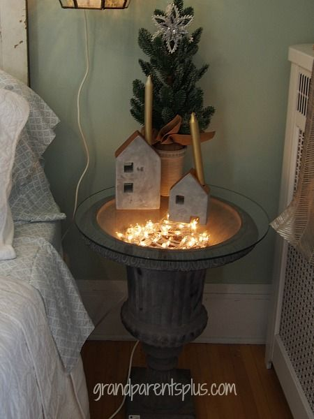 With a circle of glass on top and twig balls with Christmas lights inside, this garden urn makes for an unusual, but lovely bedside table.