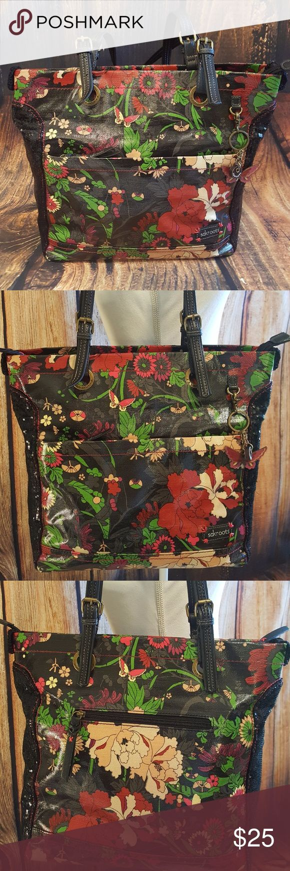 Sakroots Black Print Tote 🦋🤗🦋 Great tote to throw everything in & go by Sakroots!  Fun floral & butterfly print with sequin side panels! Lots of pockets!  Approximately 13 inches high by 15 inches wide & 5 inches deep. Fits tablets, planners, notebooks & small laptops! Print material can easily be wiped down to clean up coffee spills & just keep clean.  No rips, tears or stains, great condition!!! Sakroots Bags Shoulder Bags