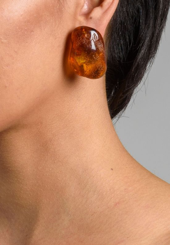 $1,065.00 | Monies UNIQUE Danish Amber Clip Ons | Monies jewelry is bold in design and strong in aesthetic. These Monies earrings are made with Danish Amber to become a pair of one-of-a-kind and edgy statement pieces. All pieces are handmade. Monies is sold online and in-store at Santa Fe Dry Goods & Workshop in Santa Fe, New Mexico.