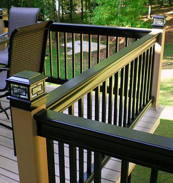 Deck Railing - Aluminum -Google Image Result for http://www.backyard-design-ideas.com/images/aluminum-railing-black-and-tan-with-post-cap-light.jpg